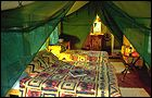 each safari tent is furnished with a queen-sized and a single bed.
